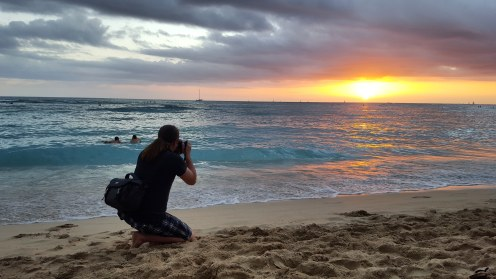 Babe being creative on the beach in Waikiki.